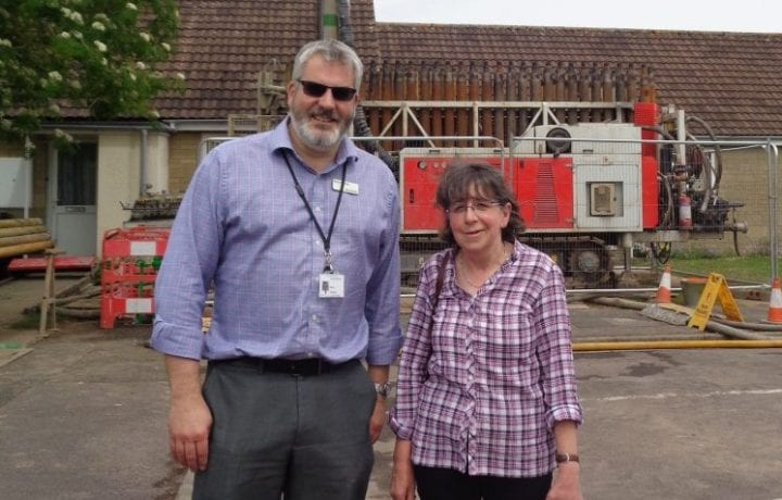 Ground Source Review: Russ Fowler Director of Financial Reporting & resident Mrs Wilson in front of drilling rig