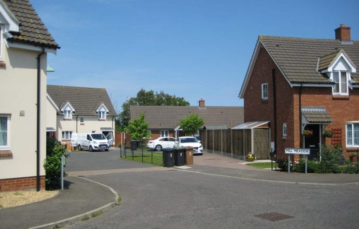 Ground Source Review: Flagship, Fressingfield - The street scene shows the diverse property make-up of the site, with the bungalows just visible to the rear.