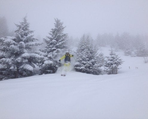 Jumping through trees in Courchevel skiing
