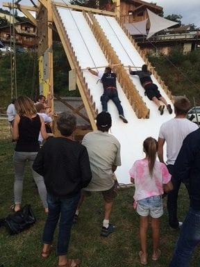 Competition between the villagers on a Ninja warrior style wall