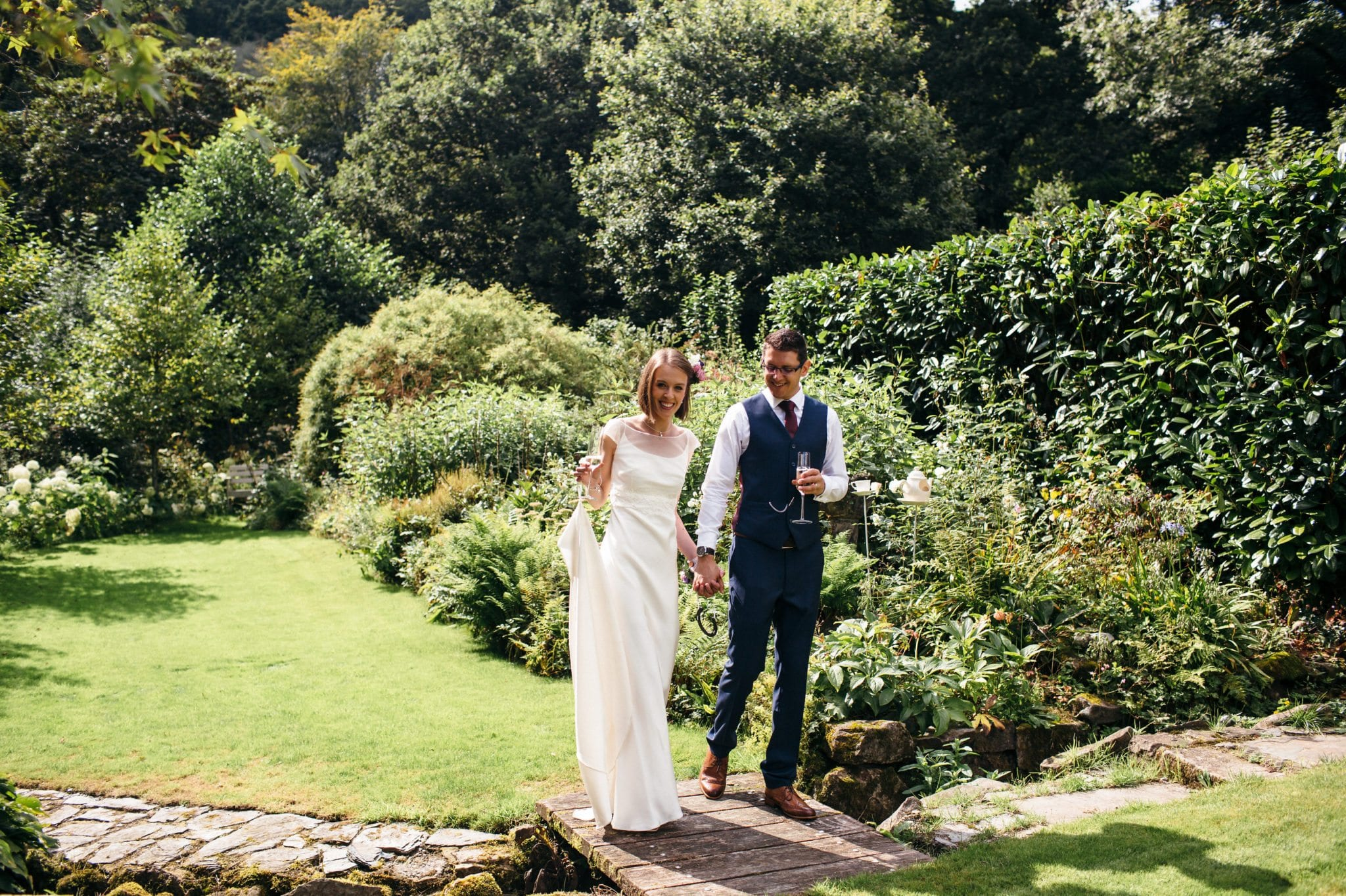 Lowri & Geoff Bride and Groom in a garden devon