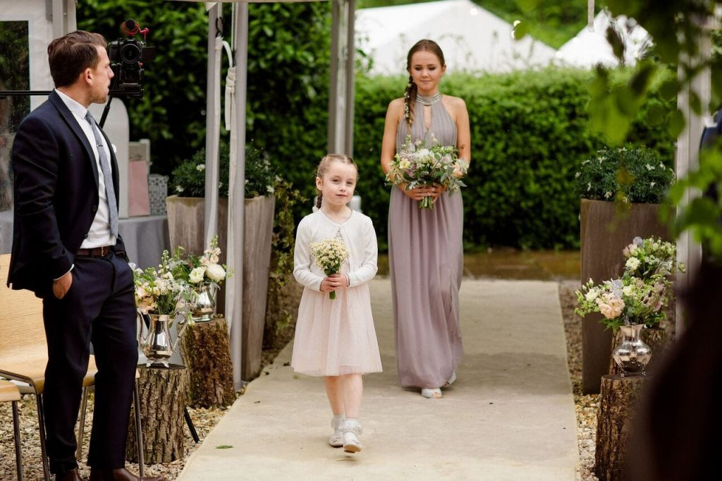 flower girls blog post walking down aisle