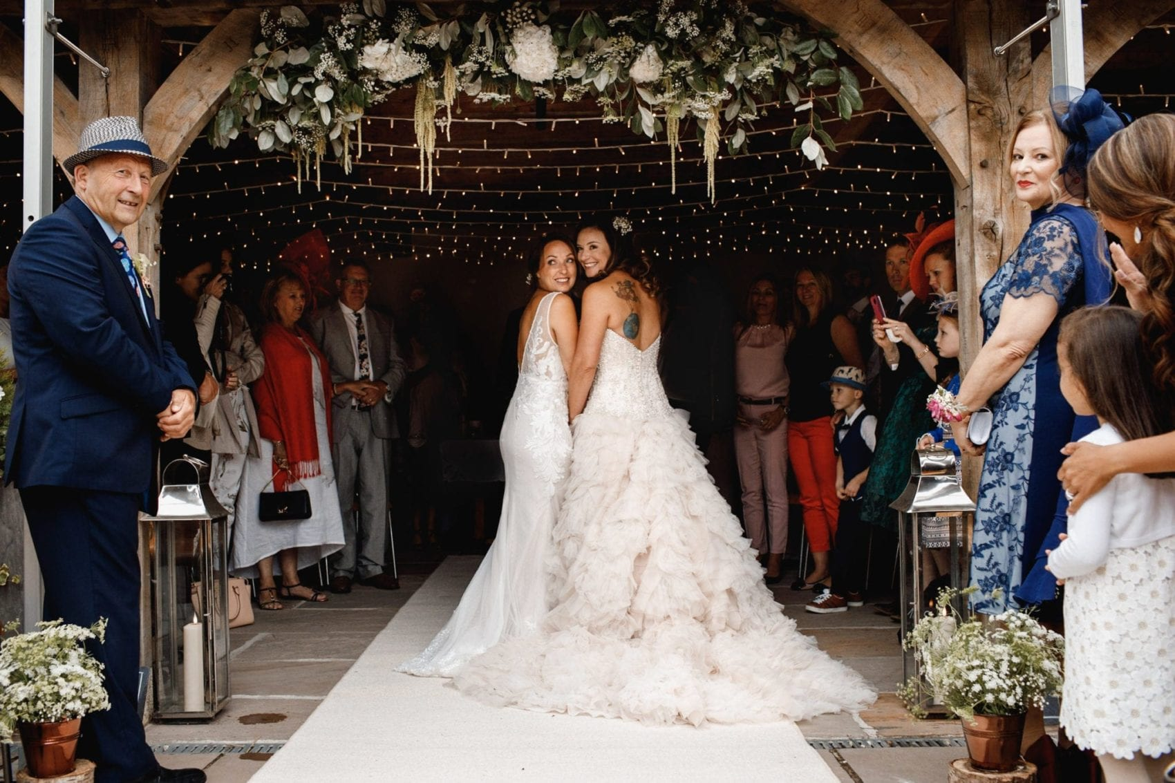 Two brides walking down the isle